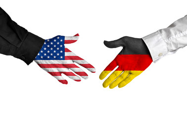 United States and Germany leaders shaking hands on a deal agreement