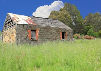 Old Australian settlers blue stone homestead in country setting