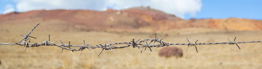 barb wire on a desert landscape