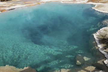 Clear, aqua, thermal pool, steaming in Yellowstone Park, Wyoming
