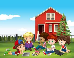 Internatinal children studying outside classroom
