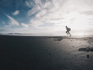 running silhouette on the shore of ocean