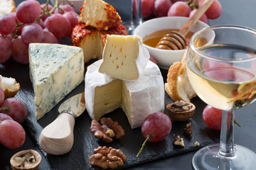 molded cheeses, wine and snacks