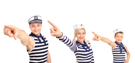 Family in sailor outfits pointing forward