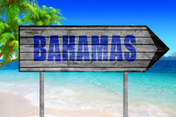 Bahamas wooden sign with beach background