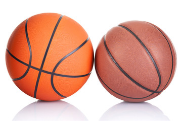 Two basketballs isolated on a white background