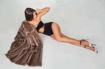 Luxury beautiful woman in fur mink coat