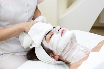 woman passes treatment mask facial at the beauty salon