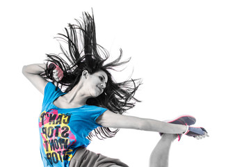 Teenager girl jumping in street dance style