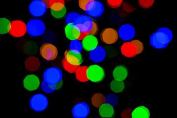 Fotobehang - colorful bright night lights over black background