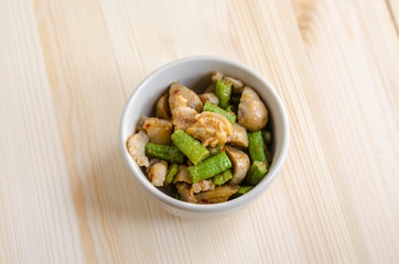 Fried spices crispy skin pork with mushroom and Yard Long bean,