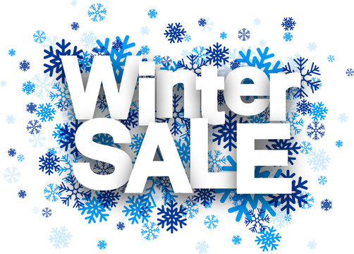 Winter sale paper sign over snowflakes.