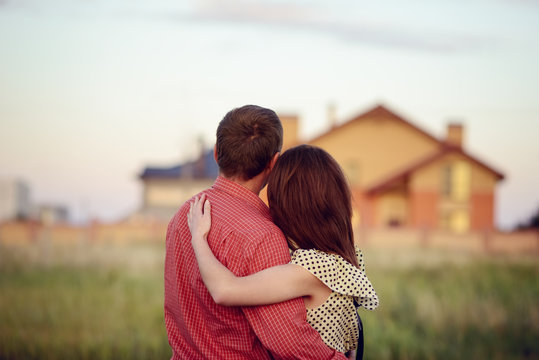loving couple looking at their home
