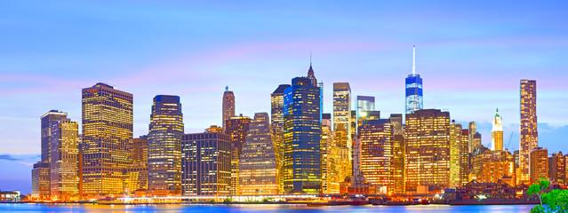 Lower Manhattan financial business buildings illuminated at sunset