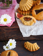 Muffins with figs.Jug of flowers.