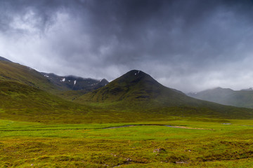 Glencoe mountains and landscape, in cloudy day, Scotland