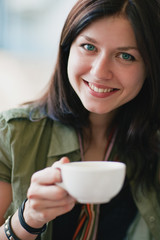 Beautiful smiling woman with a cup of tea