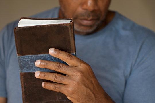 Man holding a Bible