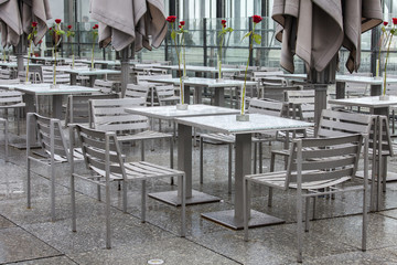 PARIS, FRANCE, on AUGUST 26, 2015. Picturesque summer cafe on a survey platform on a roof. Rainy day, wet tables with water drops