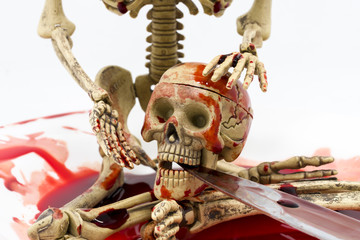 Still life skeleton in blood with knife on white background