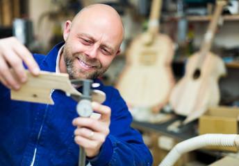 Woodworker on lathe in workroom