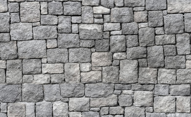 Old gray stone wall, seamless background texture Wall mural