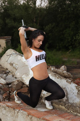 Pretty young fitness girl working out