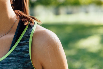 Woman's shoulder in sunlight after workout