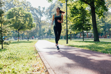Woman running on jogging path in the park