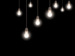 Illumination. Old style frosted light bulbs over black.