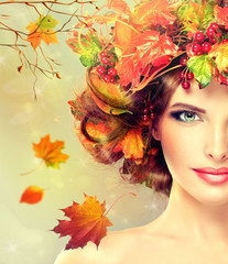 Autumn Beauty - woman fashion Makeup With Red and yellow autumn Leaves. Autumn wreath on girl head . Emotions and surprise on the face of the autumn girl .