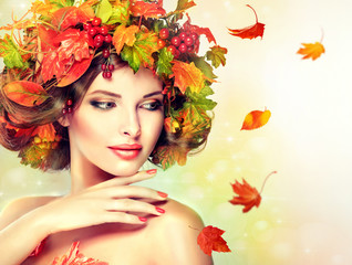 Autumn Beauty - woman fashion Makeup With Red and yellow autumn Leaves. Autumn wreath on girl head . Emotions and surprise on the face of the autumn girl