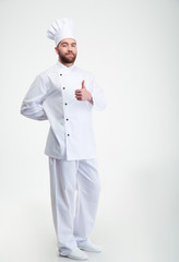 Handsome male chef cook showing thumb up sign
