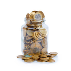 Glass jar full of coins isolated on white background