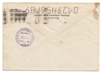 Grunge old envelope with meter stamp isolated n white background