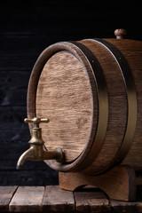 Vintage old oak barrel on wooden table still life
