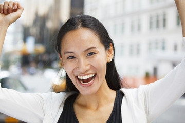 Attractive Happy Woman Arms Raised Up and Smiling