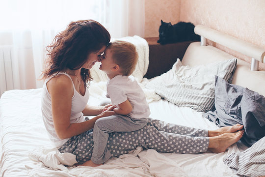 Mom relaxing with her little son