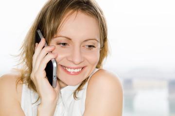 Beautiful girl talking to phone