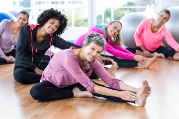 Portrait of fit women smiling while exercising