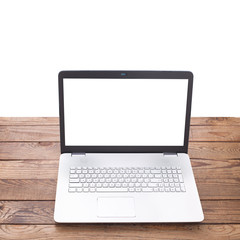 Modern laptop on wooden table isolated