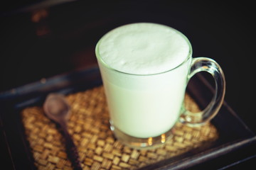 Hot milk in a glass on  wooden Backgrounds