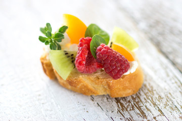 Slice of bread with fresh fruit