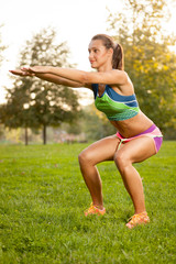 fitness woman doing yoga exercises in the park