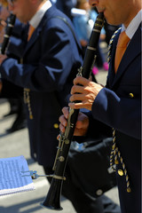 musician playing a clarinet during the patron feast.