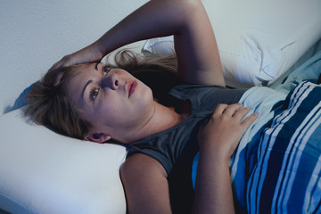 sleep disorder, insomnia. young blonde woman lying on the bed aw
