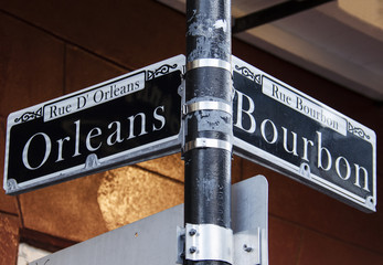 Street signs for Rue D' Orleans and Rue Bourbon in New Orleans, Louisiana
