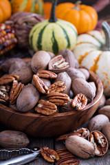 Pumpkins, nuts, indian corn and variety of squash
