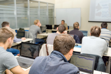 Adult programmers students in classroom