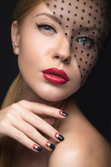 Beautiful girl with a veil, evening makeup, black and red nails